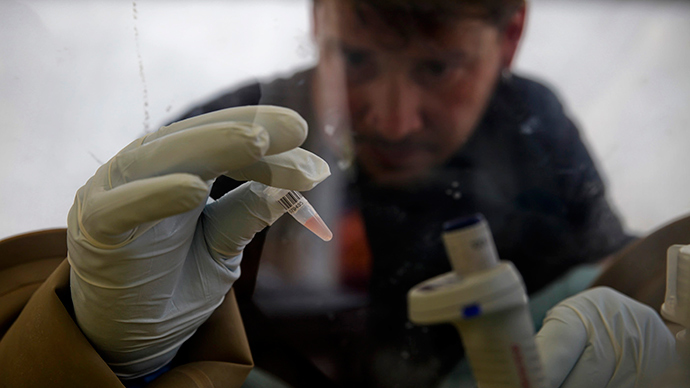 A scientist separates blood cells from plasma cells to isolate any Ebola