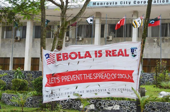 A sign outside the Monrovia City Corporation in Liberia aims at preventing the spread of Ebola.