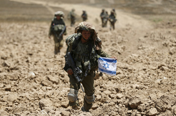Israeli soldiers from the Givati brigade return to Israel from Gaza