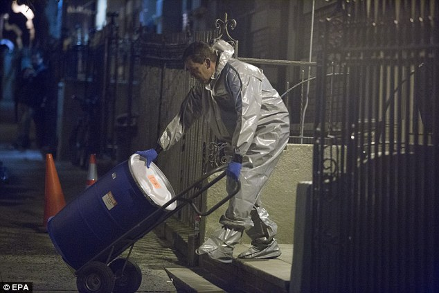 A cleaning worker wheels a barrel out of Dr Craig Spencer's apartment so it can be transported to the Centre for Disease Control - No wonder Ebola is spreading so easy!