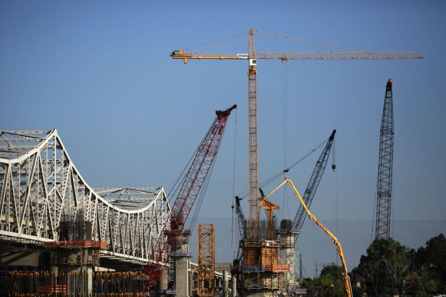 Construction crews work to erect a new highway bridge to carry I-65 traffic across the Ohio River to southern Indiana.