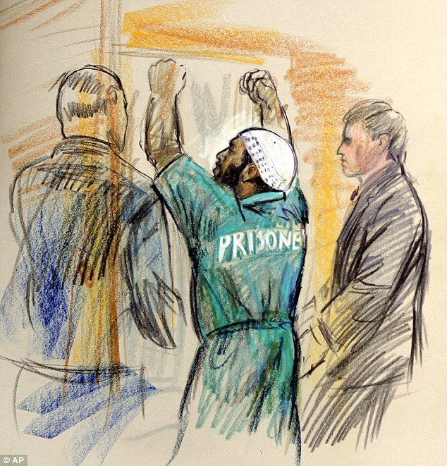 Court battles: Moussaoui cut a bizarre figure in his three-year-long trial on terror charges. Above, a court sketch shows him celebrating as he is sentenced to life in a maximum security prison