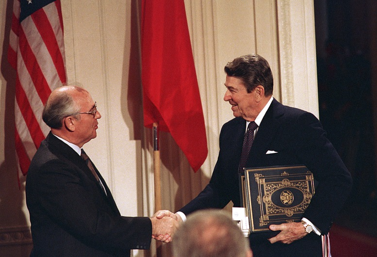 President Ronald Reagan shakes hands with Soviet leader Mikhail Gorbachev in Nuclear pact