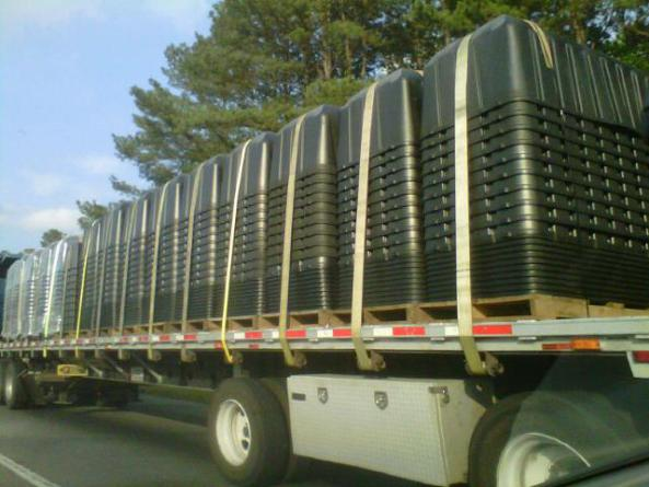 A DELIVERY OF 3 PERSON PLASTIC COFFINS...WHY AMERICA?