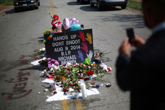 A makeshift memorial for shooting victim Michael Brown stands in the middle of Canfield Drive, where Brown was shot, in Ferguson, Missouri