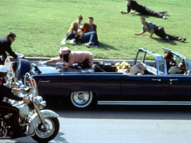 The scene at Dealey Plaza in Dallas moments after John Kennedy was shot, Nov. 22, 1963