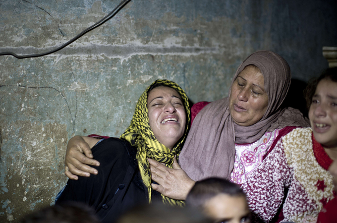 A relative said Halawa was looking for songbirds near the Israel border at the time of Sunday's shooting [AFP]