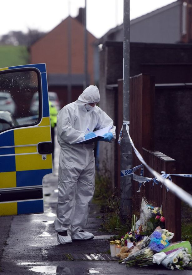 Forensic experts comb the scene where flowers and teddy bear tributes were placed by friends and neighbours