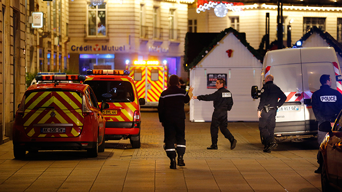 Police and rescue crews are seen near a Christmas market where a man drove a small van into a crowd, injuring ten people, including five seriously wounded, according to French media, in Nantes