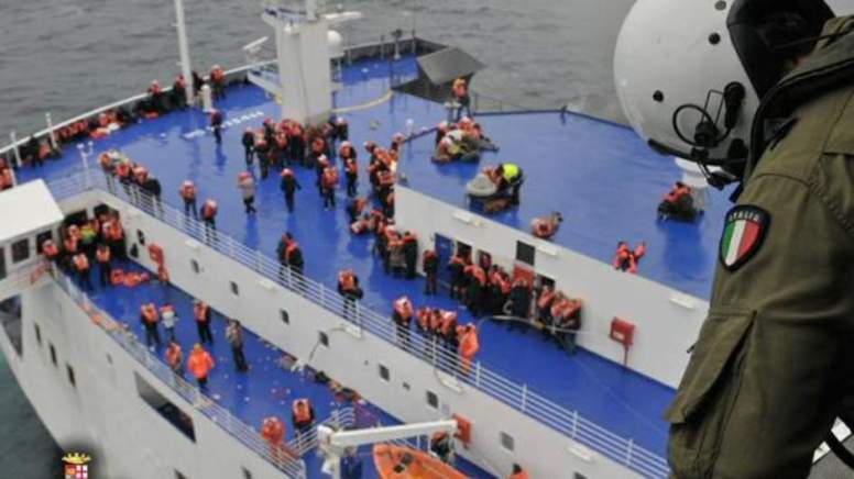 Passengers jump from the ship as those trapped on the burning vessel report choking smoke and shoes melting on the decks.