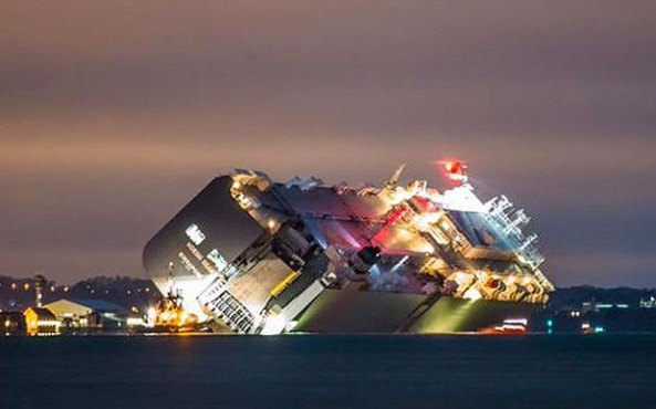 "All 25 crew are accounted for and are ""safe and well"" - but their cargo ship remains stuck in the Solent, listing at 45 degrees."